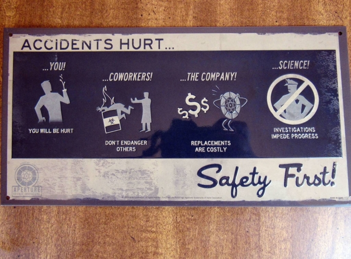 Portal - Safety First Tin Sign
